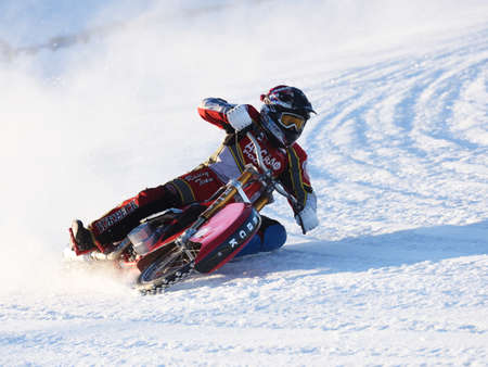 novosibirsk: Novosibirsk, Russia - December 20, 2014: Evgeny Urakov of Izhevsk during the semi-final individual rides of Russian Ice Speedway Championship. The sports returns to the sport arenas after a decline