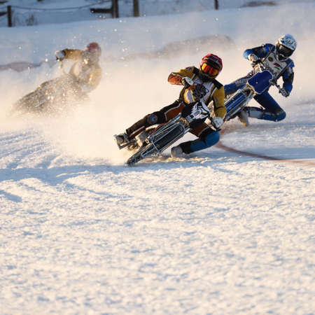 individual sport: Novosibirsk, Russia - December 20, 2014: Unidentified bikers during the semi-final individual rides of Russian Ice Speedway Championship. The sports returns to the sport arenas after a decline