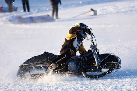 individual sport: Novosibirsk, Russia - December 20, 2014: Unidentified biker during the semi-final individual rides of Russian Ice Speedway Championship. The sports returns to the sport arenas after a decline