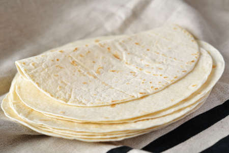 tex mex: Stack of tortillas on a towel