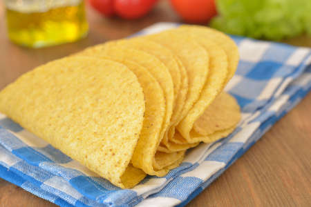 crusty: Crusty taco shells on a rustic table Stock Photo