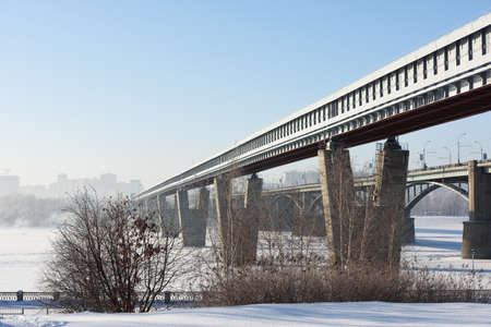 novosibirsk: Novosibirsk, Russia - December 20, 2014: Metro bridge across the Ob river in a winter day. It is the world longest metro bridge with the length 2145 m