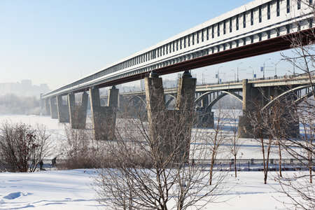 longest: Novosibirsk, Russia - December 20, 2014: Metro bridge across the Ob river in a winter day. It is the world longest metro bridge with the length 2145 m