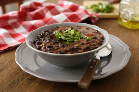 Black bean soup in a bowl Standard-Bild