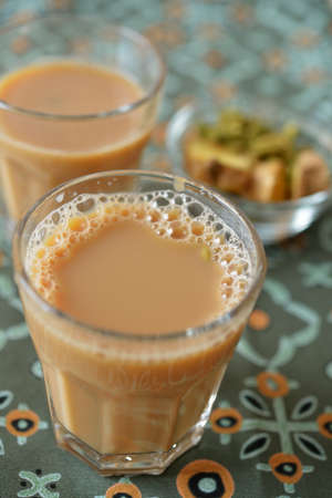 masala chai: Masala chai tea and spices. Selective focus on the froth Stock Photo