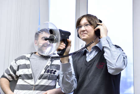 educational institution: Novosibirsk, Russia - January 15, 2015: Student use the directional microphone in the laboratory of information security of the Novosibirsk State University of Economics and Management. It is the Western Siberia largest economical educational institution