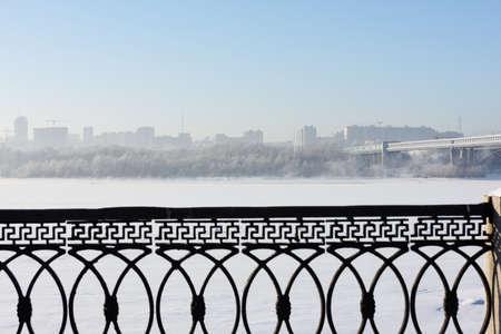 Novosibirsk, Russia - December 20, 2014: Metro bridge across the Ob river and left bank part of city. It is the world longest metro bridge with the length 2145 m