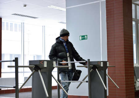 educational institution: Novosibirsk, Russia - January 15, 2015: Student passing through the turnstile into the Novosibirsk State University of Economics and Management. It is the Western Siberia largest economical educational institution