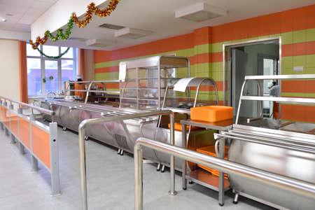 educational institution: Novosibirsk, Russia - January 15, 2015: Staff preparing to dinner in the student canteen of Novosibirsk State University of Economics and Management. It is the Western Siberia largest economical educational institution