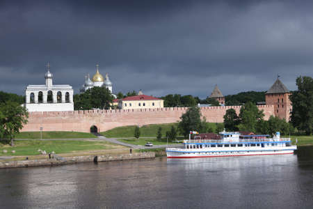 veliky: Veliky Novgorod, Russia - June 16, 2011: View to the Novgorod Kremlin from the opposite bank of Volkhov river. The current fortress was built between 1484 and 1490 is a large oval 545 meters long and 240 meter wide with nine surviving towers