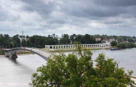 volkhov: Veliky Novgorod, Russia - June 16, 2011: View to the Yaroslavs Court from the opposite bank of Volkhov river. The Court is named after Yaroslav the Wise who, while prince of Novgorod in 988?1015, built a palace there Editorial