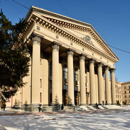 novosibirsk: Novosibirsk, Russia - February 10, 2015: People in front of the main entrance to the Siberian State University of railway engineering. Found in 1932, now it is one of the leading technical universities of Russia in the transport industry