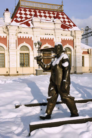 Yekaterinburg, Russia - January 1, 2015: Sculpture of railway worker in front of Museum of history, science and technics of Sverdlovsk railway. The museum located in the building of first railroad station of Yekaterinburg