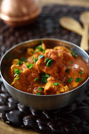 cuisines: Chicken curry in a metal bowl
