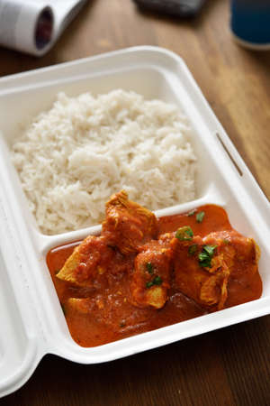 chicken curry: Chicken curry with rice in a disposable container