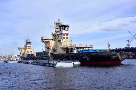 lieutenant: St. Petersburg, Russia - March 6, 2015: Icebreakers Moskva and Sankt-Peterburg anchored at the Lieutenant Schmidt embankment. Ships are designed for conduction of large tankers with width up to 50 m Editorial
