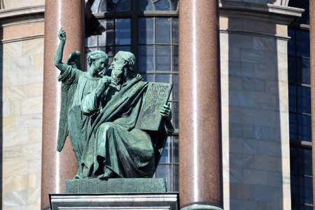 apostle: St. Petersburg, Russia - March 5, 2015: Sculpture of apostle Matthew on the St. Isaacs cathedral. Sculptures of apostles for the cathedral created by Giovanni Vitali