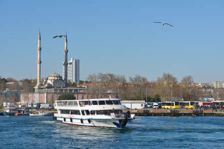 traverse: Istanbul, Turkey - March 21, 2014: Ferry boat across Bosporus strait against Kadikoy coast. The ferry is the fastest and cheapest way to traverse Bosporus strait Editorial
