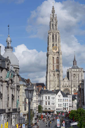 our people: Antwerp, Belgium - June 23, 2013: People on the Sukerrui street against the Cathedral of our Lady. Built between 1352 and 1521 as one of the world tallest buildings, the cathedral still dominates the city skyline Editorial