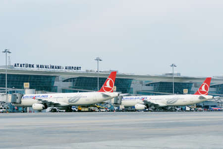 Istanbul, Turkey - March 12, 2014: Airplanes of Turkish Airlines in the Ataturk international airport. Opened in 1924, the airport is the main hub of the Turkish Airlines