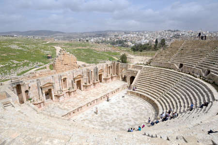 tentative: Jerash, Jordan - March 18, 2014: Tourists in the South theater in the ancient city of Jerash. Since 2004, Jerash Archaeological City is included in UNESCO Tentative List