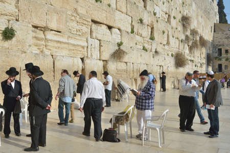 western wall: Jerusalem, Israel - March 20, 2014: Jews pray under the Western Wall in the Old city. The Old City is listed as UNESCO World Heritage site since 1981 Editorial