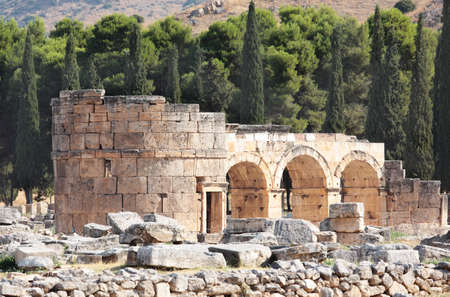 unesco world heritage site: Pamukkale, Turkey - August 18, 2011: Domitian gate of the ancient city of Hierapolis. Since 1988, the archaeological site and nearby travertine terraces are listed as UNESCO World Heritage site