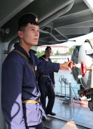 frigate: Sevastopol, Crimea, Ukraine - August 17, 2012: Seamen at the torpedo tubes on the Russian frigate Pytlivy. Built in Kaliningrad in 1981, the frigate included in the Black Sea Fleet since 1982