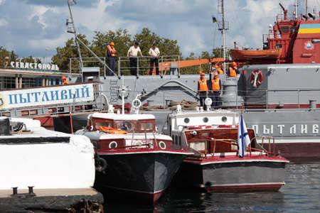 frigate: Sevastopol, Crimea, Ukraine - August 17, 2012: Seamen on the deck of Russian frigate Pytlivy. Built in Kaliningrad in 1981, the frigate included in the Black Sea Fleet since 1982 Editorial