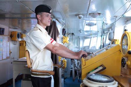 frigate: Sevastopol, Crimea, Ukraine - August 17, 2012: Midshipman on the bridge of Russian frigate Pytlivy. Built in Kaliningrad in 1981, the frigate included in the Black Sea Fleet since 1982 Editorial