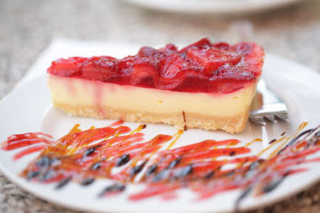 strawberry jelly: Cheesecake with strawberry jelly on a plate. Selective focus on a cheesecake