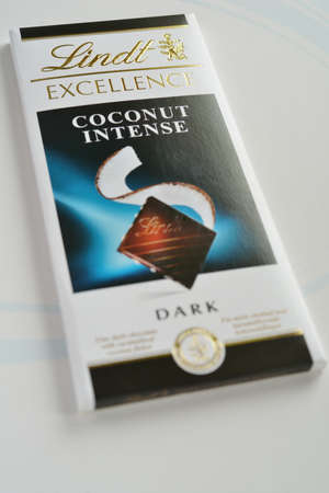 lindt: Novosibirsk, Russia - November 15, 2014: Chocolate bar Lindt Excellence coconut intense dark on white background. Founded in 1845 in Switzerland, now Lindt & Sprungli group has sites in 6 countries including USA