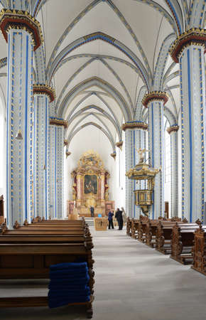 jesuit: Bonn, Germany - June 30, 2013: People in the Name of Jesus church. Built in 1686-1717 in Jesuit Gothic style, the church was damaged during WWII, restored in 1957, and now it used as cathedral and city church