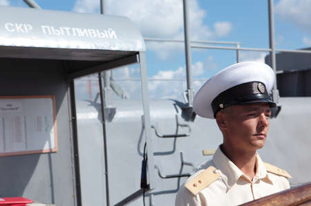 frigate: Sevastopol, Crimea, Ukraine - August 17, 2012: Midshipman on the deck of Russian frigate Pytlivy. Built in Kaliningrad in 1981, the frigate included in the Black Sea Fleet since 1982
