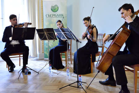 the quartet: Pavlovsk St Petersburg Russia  April 29 2015: String quartet plays during the ceremony of the return of the marble vase stolen during the WWII to the State MuseumReserve Pavlovsk