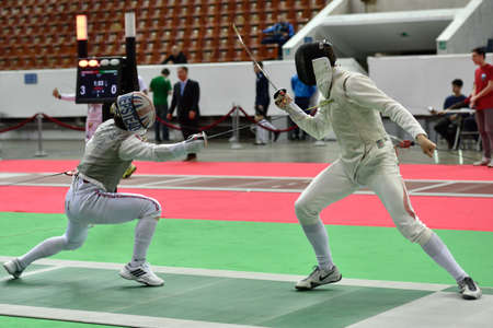 fencing foil: St. Petersburg, Russia - May 1, 2015: Marcus Mepstead of Great Britain vs Roland Schlosser of Austria during the first day of competitions in 41th International fencing tournament St. Petersburg Foil. The tournament is the stage of FIE World Cup Editorial