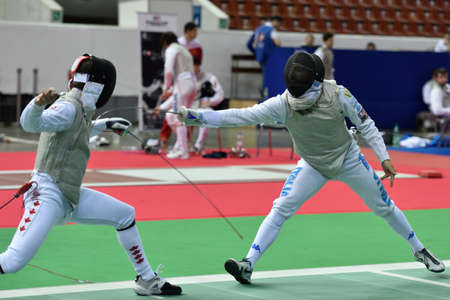 fencing foil: St. Petersburg, Russia - May 1, 2015: Francois-Olivier David of Canada vs Giorgio Avola of Italy during the first day of competitions in 41th International fencing tournament St. Petersburg Foil. The tournament is the stage of FIE World Cup