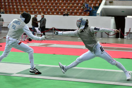fencing foil: St. Petersburg, Russia - May 1, 2015: Marcus Mepstead of Great Britain vs Piotr Janda of Poland during the first day of competitions in 41th International fencing tournament St. Petersburg Foil. The tournament is the stage of FIE World Cup