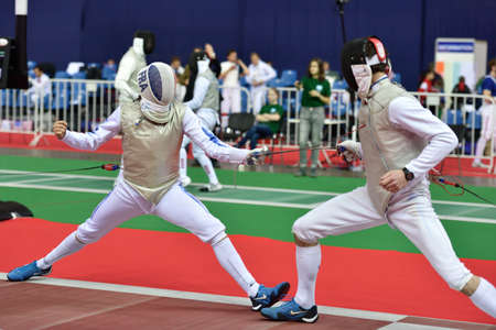 fencing foil: St. Petersburg, Russia - May 1, 2015: Vincent Simon of France vs Pavlo Syrachynskyy of Ukraine during the first day of competitions in 41th International fencing tournament St. Petersburg Foil. The tournament is the stage of FIE World Cup