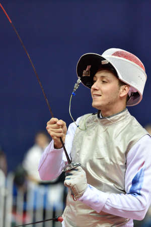 fencing foil: St. Petersburg Russia  May 1 2015: Vincent Simon of France during the first day of competitions in 41th International fencing tournament St. Petersburg Foil. The tournament is the stage of FIE World Cup