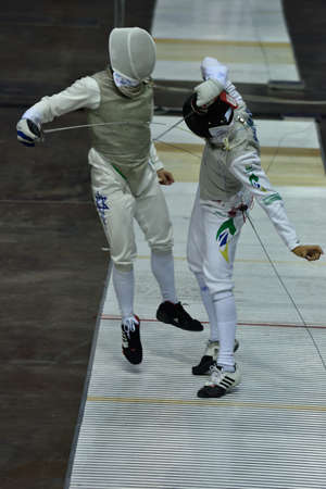 fencing foil: St. Petersburg, Russia - May 1, 2015: Maor Hatoel of Israel vs Heitor Shimbo of Brazil during the first day of competitions in 41th International fencing tournament St. Petersburg Foil. The tournament is the stage of FIE World Cup Editorial