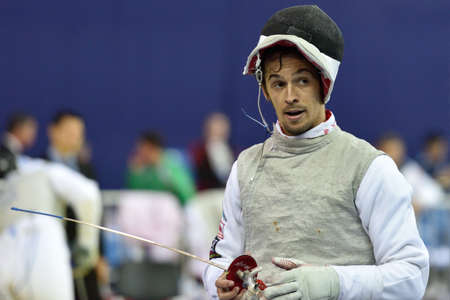 fencing foil: St. Petersburg Russia  May 1 2015: Andrea Baldini of Italy during the first day of competitions in 41th International fencing tournament St. Petersburg Foil. The tournament is the stage of FIE World Cup Editorial
