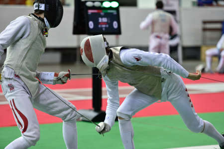 fencers: St. Petersburg, Russia - May 1, 2015: Martin Dobiasch of Austria vs Anthony Prymack of Canada during the first day of competitions in 41th International fencing tournament St. Petersburg Foil. The tournament is the stage of FIE World Cup