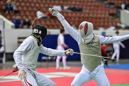 fencing foil: St. Petersburg, Russia - May 1, 2015: Martin Dobiasch of Austria vs Anthony Prymack of Canada during the first day of competitions in 41th International fencing tournament St. Petersburg Foil. The tournament is the stage of FIE World Cup