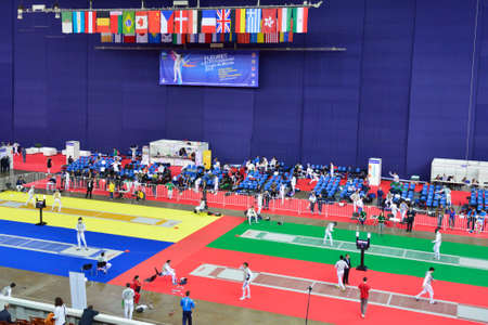 fencing foil: St. Petersburg Russia  May 1 2015: First day of competitions in 41th International fencing tournament St. Petersburg Foil. The tournament is the stage of FIE World Cup Editorial