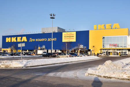 ikea: Novosibirsk Russia  January 13 2015: People and cars near the hypermarket IKEA during Christmas sales. There is a grand total of 301 IKEA stores in 37 countries