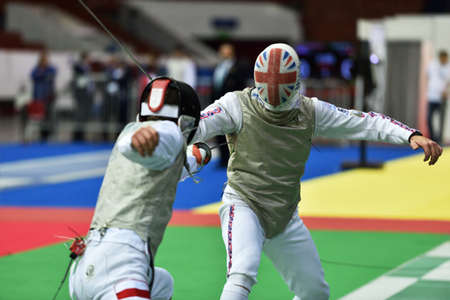 fencing foil: St. Petersburg Russia  May 2 2015: Michal Janda of Poland vs Laurence Halsted of Great Britain in 132 final of 41th International fencing tournament St. Petersburg Foil. The tournament is the stage of FIE World Cup