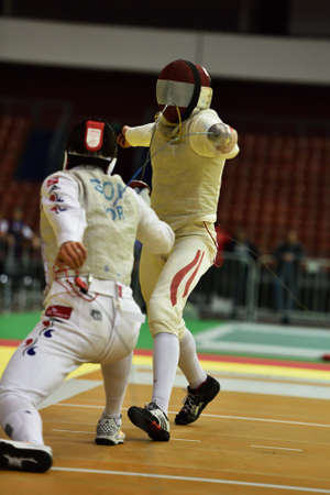 johannes: St. Petersburg Russia  May 2 2015: Young Ki Son of Korea vs Johannes Poscharnig of Austria in 132 final of 41th International fencing tournament St. Petersburg Foil. The tournament is the stage of FIE World Cup