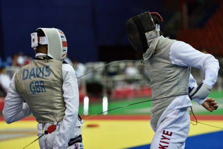 thrust: St. Petersburg Russia  May 2 2015: James Andrew Davis of Great Britain vs Engin Batuhan Menkuer of Turkey in 132 final of 41th International fencing tournament St. Petersburg Foil. The tournament is the stage of FIE World Cup