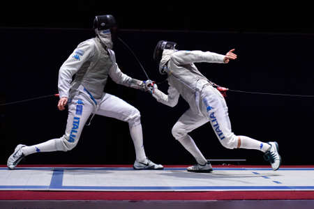 daniele: St. Petersburg Russia  May 2 2015: Andrea Cassara of Italy left vs Daniele Garozzo of Italy in semifinal of 41th International fencing tournament St. Petersburg Foil. The tournament is the stage of FIE World Cup Editorial